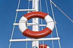 Life buoy and sailing mast Royalty Free Stock Photos