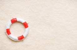 Life buoy on sand Royalty Free Stock Photography