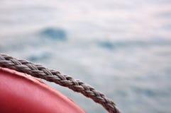 Life buoy on sea background Stock Photo