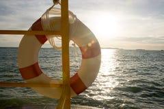 Life buoy and sea sunset Royalty Free Stock Photo