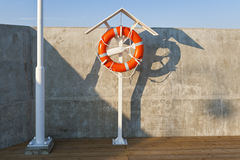 Life buoy on the seaside Royalty Free Stock Photo