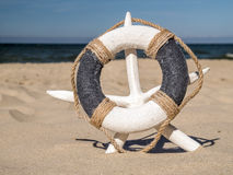 Life buoy and starfish on the beach Royalty Free Stock Photography