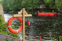 Life buoy station on a construction site which involves the two banks of a river - 2/2 stock image