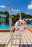 Life buoy in swimming pool Royalty Free Stock Photo