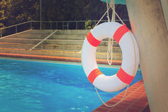 Life buoy and swimming pool Stock Photos