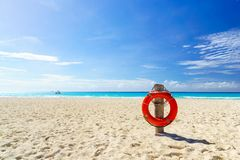 Life buoy on the tropical beach Stock Image