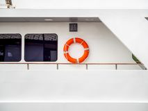 Life buoy on the wall on travel boat royalty free stock photography