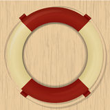 Life buoy on a wooden background Stock Photo