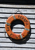 Life buoy on a wooden wall Royalty Free Stock Image