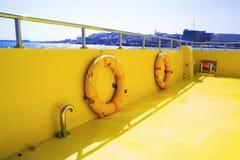 Life buoys on a boat`s deck. Stock Photos