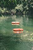 Life buoys floating on waters of Formoso river. A river with transparent green water surrounded by nature on Bonito MS, Brazil. Safety scenery Royalty Free Stock Photos