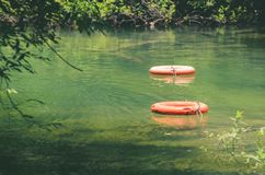 Life buoys floating on waters of Formoso river. A river with transparent green water surrounded by nature on Bonito MS, Brazil. Safety scenery Stock Image