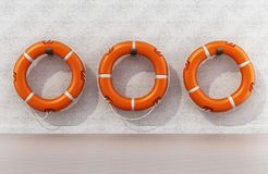 Life buoys hanging on the wall. 3D illustration royalty free illustration