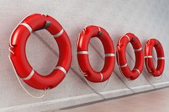 Life buoys hanging on the wall. 3D illustration stock illustration