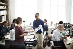 Daily life of business people at the office Stock Photos