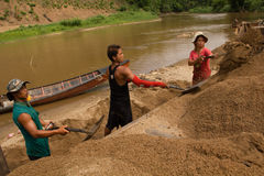 03-06-2017 sand scooping career Sand is a component in construction. Used in mixing with mortar. Villagers along the Pai river, sa Royalty Free Stock Photo