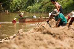 03-06-2017 sand scooping career Sand is a component in construction. Used in mixing with mortar. Villagers along the Pai river, sa Royalty Free Stock Image