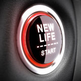 Life Change Concept. Push button with the text New Life Start. Conceptual 3D render image with blur effect for illustration of changes and attainment of Stock Image