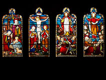 Life of Jesus Christ in Stained Glass. Stained glass window with four panes showing the birth, crucifixion, resurrection and ascension into Heaven of Jesus stock photos