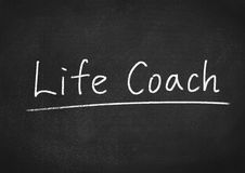 Life coach. Concept text on blackboard background royalty free stock photos