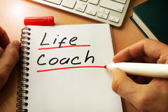 Life coach. Notepad with handwriting title life coach stock photography