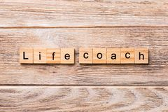 Life coach word written on wood block. Life coach text on wooden table for your desing, concept.  royalty free stock photo