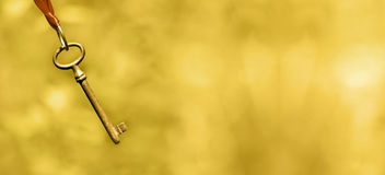 Life coaching banner in gold. Key and success - golden website banner of life coaching concept Stock Photo