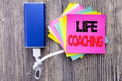 Life Coaching. Business concept for Personal Coach Help written on sticky note with copy space on old wood wooden background with. Life Coaching. Business Stock Photography