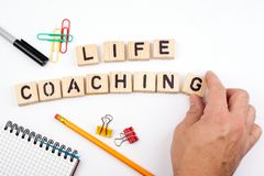 Life coaching. Wooden letters on a white background Stock Photo