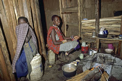 Daily life, cooking in interior Maasai hut, Kenya Royalty Free Stock Photos