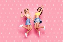 Life is cool Full length body size view of beautiful attractive funny cheerful careless girls in casual trendy outfit stock image