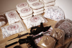 Life of criminals. Drug packages, raw opium, drug dozens and weapons seized by police Royalty Free Stock Photos