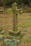 Life and Death. Cross and snodrops in Edale Churchyard Stock Images