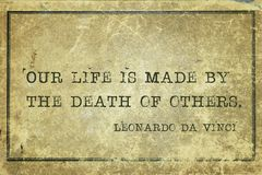Life and death DaVinci. Our life is made by the death of others - ancient Italian artist Leonardo da Vinci quote printed on grunge vintage cardboard Stock Photo