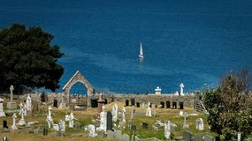 An old cemetery and a boat in Llandudno Wales United Kingdom stock photo