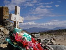 Cycle of life in the Mexican desert. A crucifix sits in contrast to Mexicos deep desert royalty free stock photo