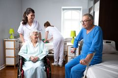 Life of elderly people at nursing home. Care of the old people stock photos