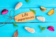 Life experiences text on paper tag
