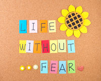 Life without fear. Conceptual words with decoration on cork Royalty Free Stock Photography