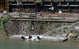 Life in Fenghuang China. FENGHUANG - April 13:local people who live in Fenghuang are washing their cloths near the river in Fenghuang ancient town on April 13 stock photo