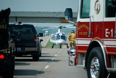 Life Flight Rescue 1. A life flight rescue taking place on I35 in Texas (helicopter, firetruck, fireman Royalty Free Stock Image