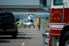 Life Flight Rescue 3. A life flight rescue taking place on I35 in Texas (helicopter, firetruck, fireman Royalty Free Stock Photos