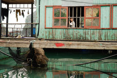 Life in floating village in Ha Long Bay Stock Photo