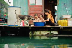 Life in floating village in Ha Long Bay Stock Photos