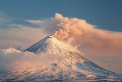 Evening volcanic eruption stock images