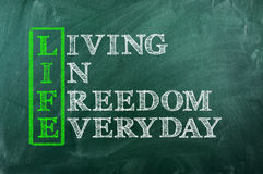 Life freedom. Acronym concept of Life  and other releated words on green chalkboard Royalty Free Stock Photography