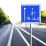 A Life Fulfilled Road Sign on a Speedy Background. royalty free stock photos