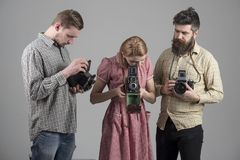 Life is full of beautiful moments remember them. Photography studio. Photographers with vintage old cameras. Group of. People with retro cameras. Retro style royalty free stock images