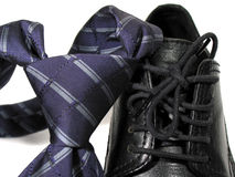 Life is full of knots :-). Close-up of tie and shoes Stock Image