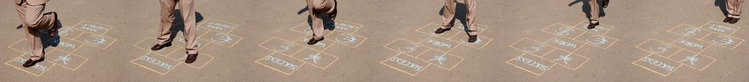 Life is a game. Man playing a business hopscotch (motion image made from six 8mp full size images Stock Photography
